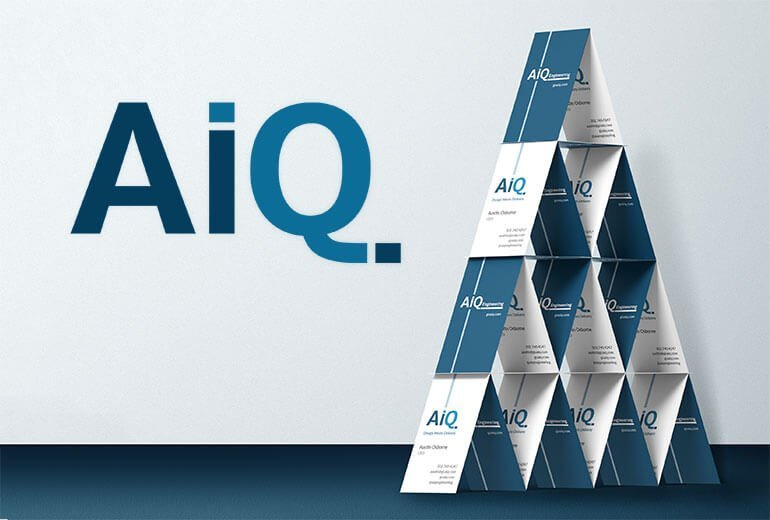 AiQ logo with a pyramid of business cards