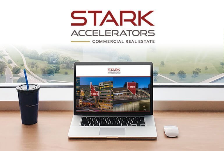 Stark Accelerators logo and website on a laptop computer